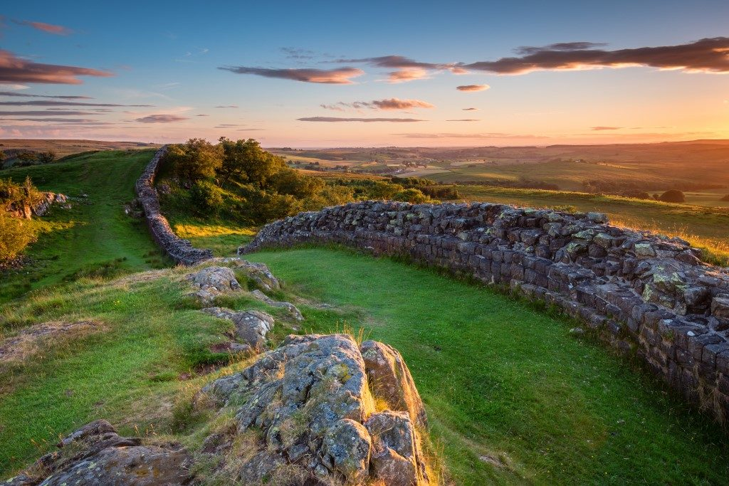 Beautiful picture taken of ancient Roman ruin Hadrian's Wall at sunset