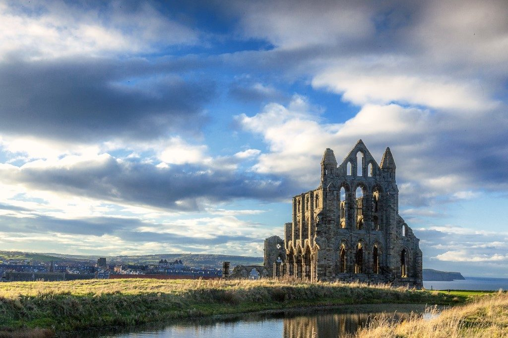 Dramatic picture taken of Whitby Abbey on an overcast day with dark clouds.