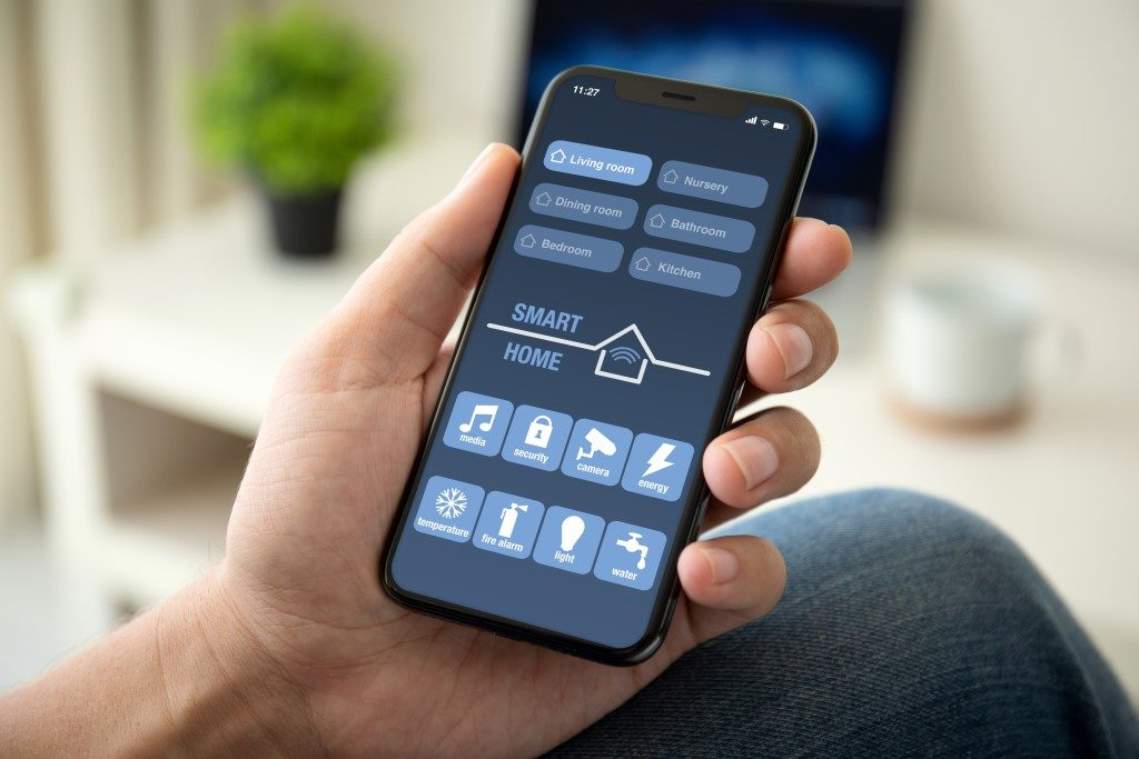 picture of smart phone controlling all smart devices in home